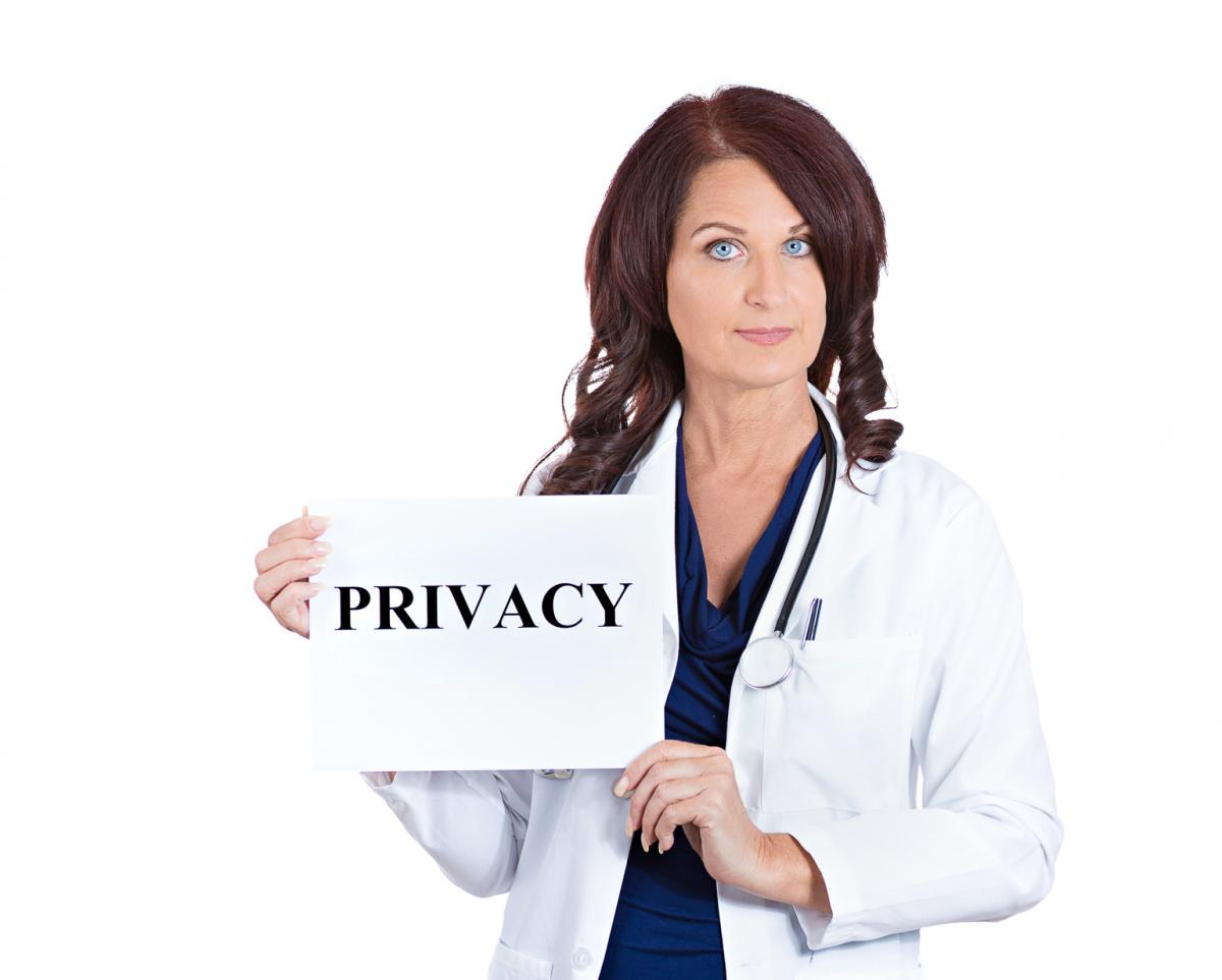 Woman Doctor holding a Privacy Sign
